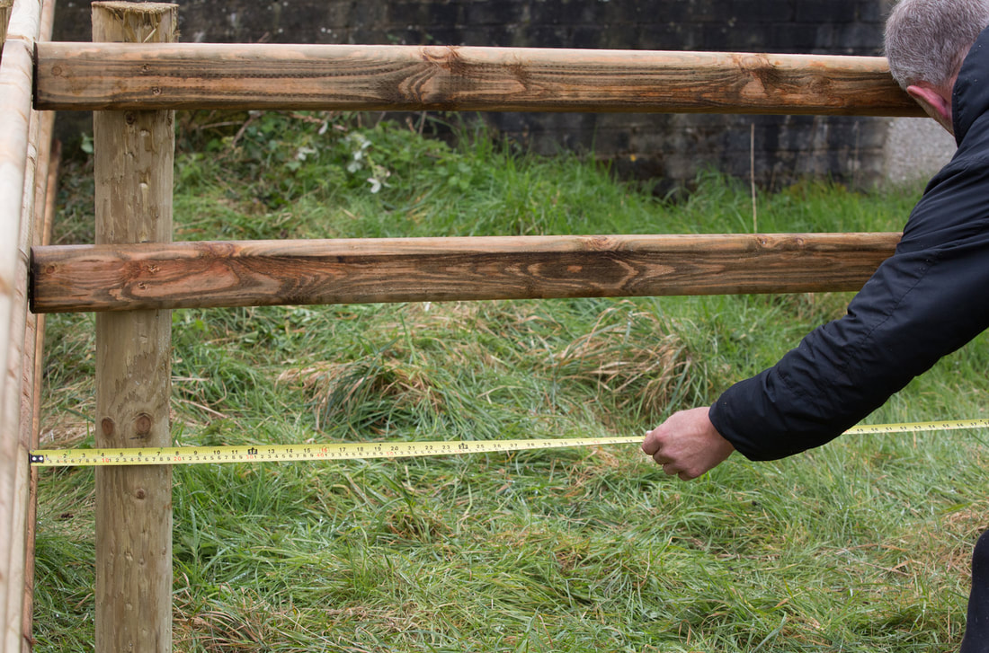 wooden rail fence being built construction