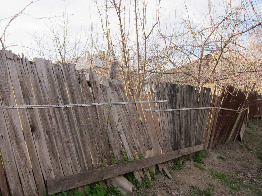 Damaged broken privacy fence beyond repair tear down replace